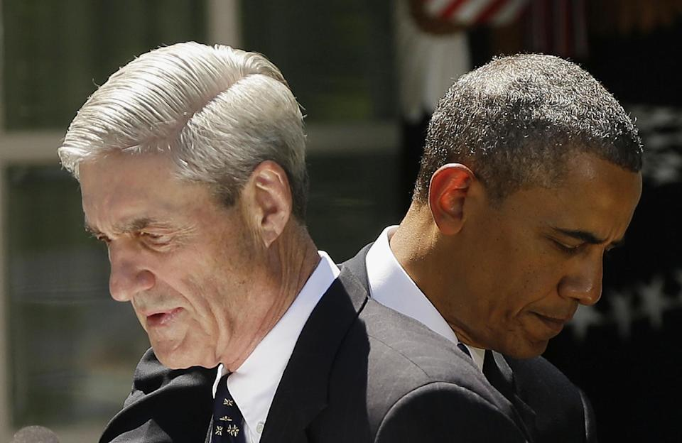 President Barack Obama and outgoing FBI Director Robert Mueller are seen in the Rose Garden of the White House in Washington, Friday, June 21, 2013, where the president announced he would nominate James Comey, a senior Justice Department official under President George W. Bush, to replace Mueller, as FBI director. (AP Photo/Pablo Martinez Monsivais)