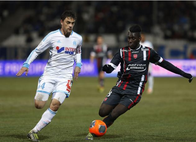 Olympique Marseille's Lucas Mendes challenges Valenciennes' Arthur Masuaku during their French Ligue 1 soccer match at the Velodrome Stadium in Marseille