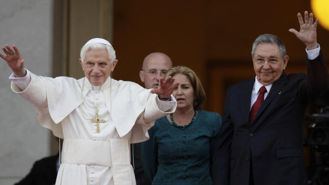 Pope Benedict XVI and Cuban President Raul Castro walk outside the Revolution palace at the end of their meeting in Havana, Tuesday, March 27, 2012.  The meeting took place behind closed doors on the pontiff's second day on the island.(AP Photo/Javier Galeano)