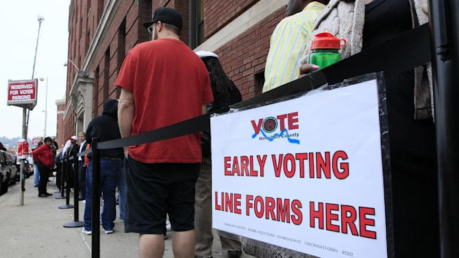 FILE - In this Oct. 2, 2012 file photo, voters stand in line outside the Hamilton County Board of Elections just before it opened for early voting, in Cincinnati. The Supreme Court is siding with Democrats in refusing to block early voting in the battleground state of Ohio. The court on Tuesday refused a Republican request to get involved in a dispute over early voting in the state on the three days before Election Day.  (AP Photo/Al Behrman, File)