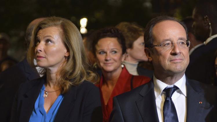 File photo of French President Francois Hollande and companion Valerie Trierweiler visiting the September 11 Memorial at Ground Zero, in New York