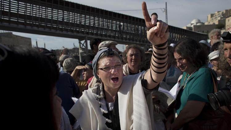 "A Jewish women from the ""Women of the Wall"" organization, leads a prayer, at the Western Wall, the holiest site where Jews can pray in Jerusalem's old city, Friday, May 10, 2013. The ""Women of the Wall"" group has been holding monthly prayer services on the first day of the Hebrew month at the Western Wall in Jerusalem for more than two decades, wearing prayer shawls and performing religious rituals reserved for men under Orthodox Judaism. Accused by ultra-Orthodox leaders of violating ""local custom"" at the holy site, many members have been arrested. On Friday the tables were turned because of the court ruling. Police protected the women and arrested three ultra-Orthodox men for disorderly conduct, police spokesman Micky Rosenfeld said. (AP Photo/Bernat Armangue)"