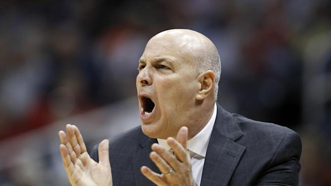 """In this March 8, 2012, photo, Virginia Tech coach Seth Greenberg applauds during an NCAA college basketball game against Clemson in the first round of the Atlantic Coast Conference men's tournament in Atlanta. Virginia Tech has fired Greenberg. Athletic director Jim Weaver made the announcement Monday, April 23, 2012, saying """"we need to go in another direction."""" (AP Photo/John Bazemore)"""