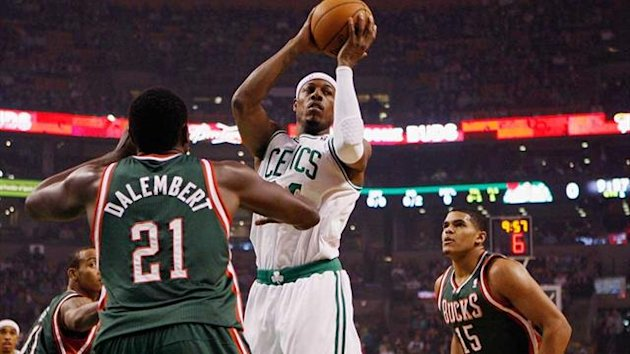 Boston Celtics&#39; Paul Pierce looks to pass between Milwaukee Bucks&#39; Samuel Dalembert and Tobias Harris during basketball NBA game in Boston (Reuters)