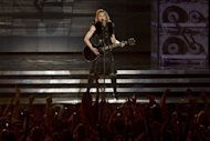 US pop icon Madonna performs on stage during her first MDNA world tour concert in the Ramat Gan Stadium, near Tel Aviv. Madonna&#39;s Tel Aviv concert sold 32,000 tickets and it is the first in her world tour spanning 30 countries and 86 concert dates