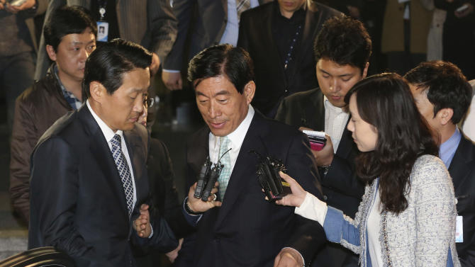 """In this photo taken on Tuesday, April 30, 2013, former National Intelligence Service director Won Sei-hoon, center, leaves Supreme Prosecutors' Office after being summoned, in Seoul, South Korea. The scandal shaking up South Korea's main spy agency is not cloak-and-dagger stuff, but the kind of low-grade trickery anyone with an Internet connection could pull off. And the target was not Seoul's opaque rival to the north, but the country's own people. Internet postings ostensibly from ordinary South Koreas, but actually from National Intelligence Service agents, allegedly boosted President Park Geun-hye while she was running for the job as the ruling party's nominee. She was reportedly dubbed """"the best,"""" while her opponent, in a play on his name, was called """"criminal."""" (AP Photo/Yonhap, Im Hun-jung) KOREA OUT"""