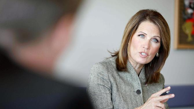 FILE - In this Oct. 16, 2012 file photo, Rep. Michele Bachmann, R-Minn. talks at a medical device roundtable event at Rasmussen College, in Blaine, Minn. Bachmann's tendency to cause a ruckus on Capitol Hill made her a tea party sensation. Her bulging campaign treasury and conservative district make her a clear favorite to win a fourth House term on Election Day, despite her Democratic rival's attempts to turn her won't-budge philosophy into a liability. (AP Photo/Stacy Bengs, File)