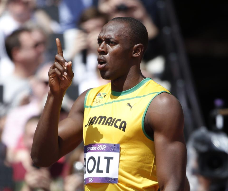 Jamaica's Usain Bolt gestures before competing in a men's 100-meter heat during the athletics in the Olympic Stadium at the 2012 Summer Olympics, London, Saturday, Aug. 4, 2012. (AP Photo/Matt Dunham)