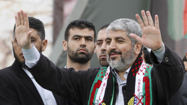 Hamas chief Khaled Mashaal waves to Palestinian Hamas supporters during a rally to commemorate the 25th anniversary of the Hamas militant group, in Gaza city, Saturday, Dec. 8, 2012. The Leader of the Islamic militant group Hamas vowed to continue fighting Israel Saturday as hundreds of thousands of flag-waving Gazans turned out for a mass rally to celebrate the 25th anniversary of the Hamas militant group, which has seen its clout and regional acceptance soar since last month's eight-day conflict with Israel.(AP Photo/Hatem Moussa)