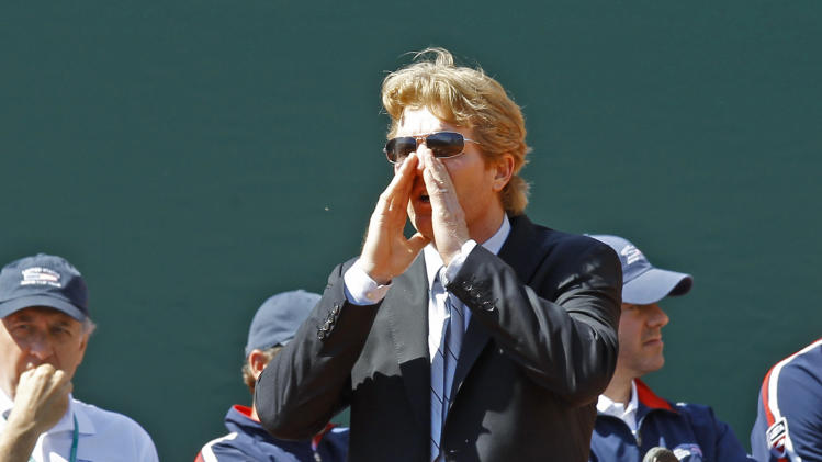 U.S. Davis Cup team captain  Jim Courier, shouts to Ryan Harrison, during his match against France's Jo-Wilfried Tsonga, in the quarterfinal of the Davis Cup between France and USA in Monaco, Friday April 6, 2012.(AP Photo/Remy de la Mauviniere)