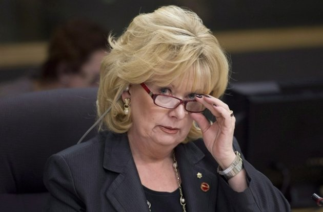 Senator Pamela Wallin, chair of the National Security and Defence committee, adjusts her glasses at the start of a meeting, Monday February 11, 2013 in Ottawa. Senator Wallin has stepped down from the Conservative caucus pending the result of an audit of her expenses. THE CANADIAN PRESS/Adrian Wyld
