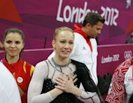 Romania's Sandra Raluca Izbasa celebrates after winning the women's vault final of the artistic gymnastics event of the London Olympic Games at the 02 North Greenwich Arena in London. Izbasa won the gold