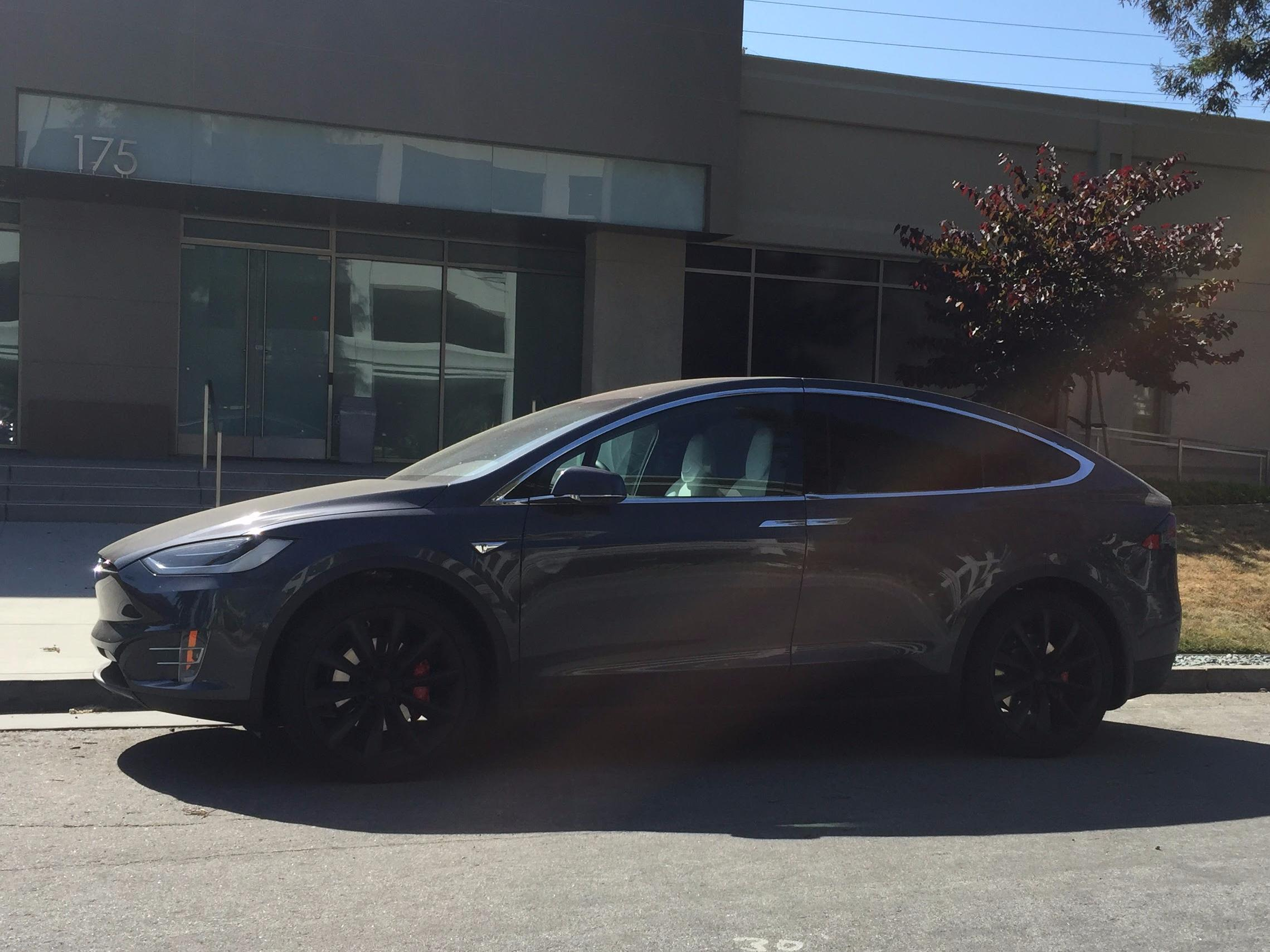 We saw these brand new Tesla Model Xs parked outside Apple's secret car office