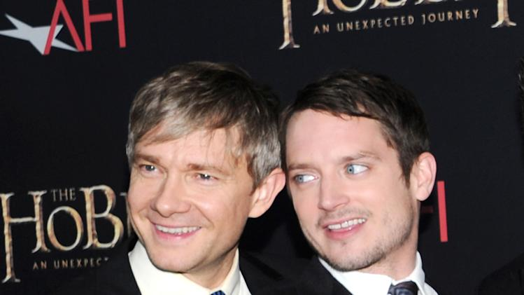 "Actors Martin Freeman, left, and Elijah Wood attend the premiere of ""The Hobbit: An Unexpected Journey"" at the Ziegfeld Theatre on Thursday Dec. 6, 2012 in New York. (Photo by Evan Agostini/Invision/AP)"