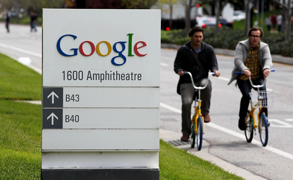 FILE- In this Thursday, April 12, 2012, file photo, Google workers ride bikes outside of Google headquarters in Mountain View, Calif.  Google Inc. reports quarterly financial results after the market closes on Thursday, July 19, 2012. (AP Photo/Paul Sakuma, File)