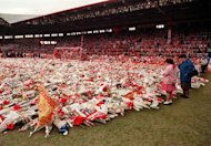 Thousands of wreaths are displayed at Anfield stadium April 20, 1989 in memory of the 96 fans who died after support railings collapsed during a match between Liverpool and Nottingham Forest. The Hillsborough Independent Panel report found that senior police officers had mounted a concerted campaign to cover up their errors in the worst disaster in British football history