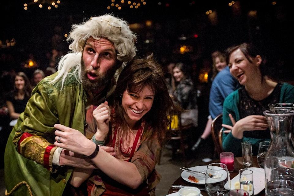 "This undated theater image released by The Hartman Group shows Blake DeLong, left, with an audience member in ""Natasha, Pierre and the Great Comet of 1812,"" a dinner theater performance that opened Thursday, May 15, 2013 in the meatpacking district of New York. (AP Photo/The Hartman Group, Chad Batka)"