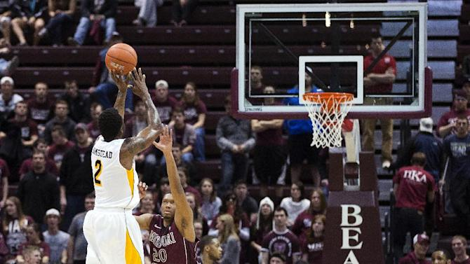 Wichita State guard Malcolm Armstead (2) shoots a 3-pointer over Missouri State forward Gavin Thurman (20) during the second half of an NCAA college basketball game, Wednesday, Jan. 23, 2013, in Springfield, Mo. Wichita State won 62-52. (AP Photo/David Welker)