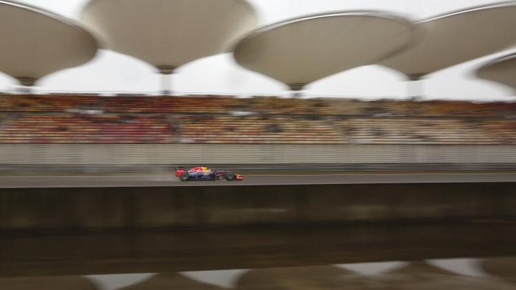 Red Bull Formula One driver Vettel of Germany drives during the third practice session of the Chinese F1 Grand Prix at the Shanghai International circuit