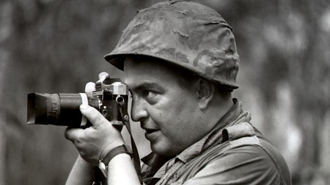 FILE - In this 1967 file photo Associated Press photographer Horst Faas works in Vietnam. Faas, a prize-winning combat photographer who carved out new standards for covering war with a camera and became one of the world's legendary photojournalists in nearly half a century with The Associated Press, died Thursday May 10, 2012. He was 79. (AP Photo)