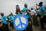 Demonstrators including ethnic Kachins, artists and civil society groups, walk through downtown Yangon in a peace rally, on September 21. Hundreds of people gathered in Yangon calling for an end to the festering conflict between Kachin ethnic minority rebels and Myanmar's army