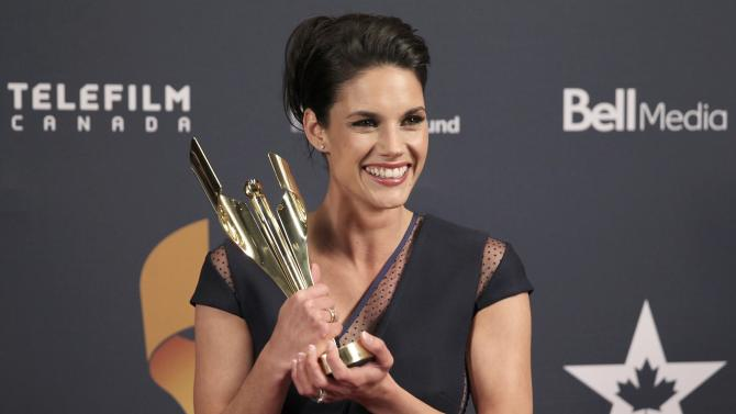 "Missy Peregrym poses with the Golden Screen Award for TV drama for the series ""Rookie Blue"" at the 2015 Canadian Screen Awards in Toronto"