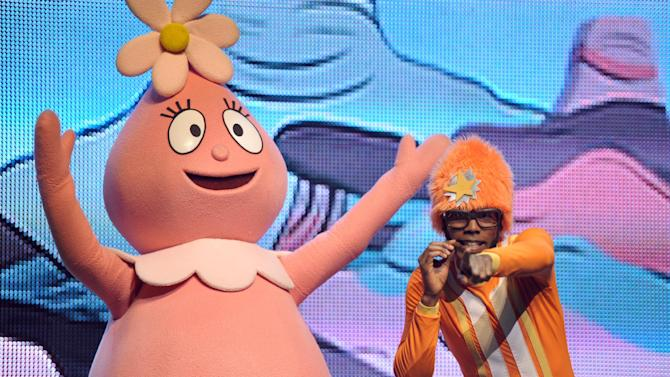 DJ Lance Rock, right, and Foofa perform onstage at Yo Gabba Gabba! Live!: Get The Sillies Out! 50+ city tour kick-off performance on Thanksgiving weekend at Nokia Theatre L.A. Live on Friday Nov. 23, 2012 in Los Angeles. (Photo by John Shearer/Invision for GabbaCaDabra, LLC./AP Images)