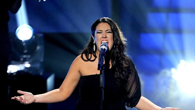 File - In this Wed., May 1, 2013 photo released by FOX, contestant Kree Harrison performs onstage at FOX's American Idol Season 12 Top 4 To 3 Live Performance Show, in Hollywood, Calif. The current 12th season is set to conclude next Thursday, May 16, 2013, with a showdown between 23-year-old R&B vocalist Candice Glover of St. Helena Island, S.C., and the 22-year-old country crooner Harrison of Woodville, Texas.(AP Photo/FOX, Frank Micelotta)
