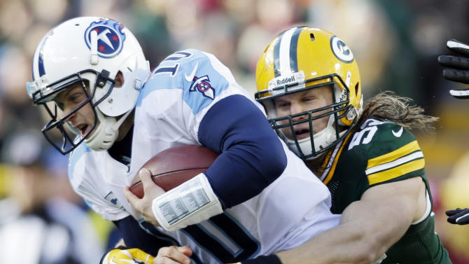 Green Bay Packers' Clay Matthews sacks Tennessee Titans quarterback Jake Locker (10) during the first half of an NFL football game Sunday, Dec. 23, 2012, in Green Bay, Wis. (AP Photo/Jeffrey Phelps)