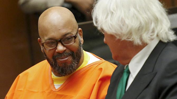 "Defendant Marion ""Suge"" Knight smiles as he speaks with attorney Thomas Mesereau as he attends a hearing in his murder case in Los Angeles, California"