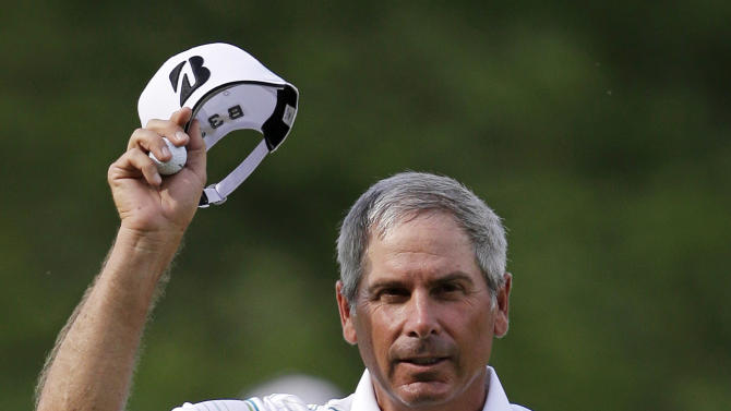 Fred Couples celebrates his birdie on the 18th green during the third round of the Senior Players Championship golf tournament at Fox Chapel Golf Club in Pittsburgh, Saturday, June 29, 2013. Couples leads the tournament after 54 holes at 15 under par. (AP Photo/Gene J. Puskar)