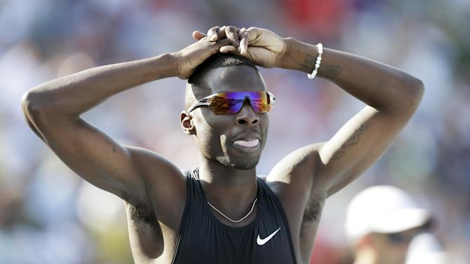 In this June 20, 2013 file photo, Torrin Lawrence reacts after his heat in the senior men's 400-meter dash at the U.S. Championships athletics meet in Des Moines, Iowa. Former University of Georgia 400-meter runner Torrin Lawrence died in a car accident early Monday, July 28, 2014 in Cordele, Ga. He was 25