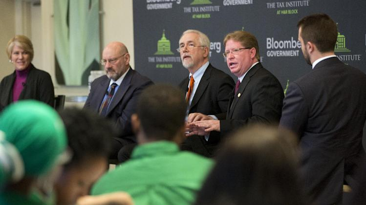 Dr. Michael W. Garner, President and CEO, Florida Association of Health Plans, second from right, speaks during an event on the tax implications of health care reform, Thursday, February 28, 2013 in Tallahassee, Fla. The event is part of a multi-city engagement tour hosted by The Tax Institute at H&R Block and Bloomberg Government examining the effects of the Affordable Care Act on consumers, small businesses and the uninsured. (Colin Hackley / AP Images for The Tax Institute at H&R Block)