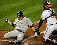 Russell Martin of the New York Yankees is tagged out at home trying to score against Matt Wieters of the Baltimore Orioles in the top of the seventh inning during Game One of the American League Division Series, at Oriole Park at Camden Yards, in Baltimore, Maryland. The Yankees won 7-2