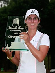 MOBILE, AL - MAY 19: Jennifer Johnson poses with the trophy after winning the Mobile Bay LPGA Classic at the Crossings Course at the Robert Trent Jones Trail at Magnolia Grove  on May 19, 2013 in Mobile, Alabama.  (Photo by Chris Trotman/Getty Images)