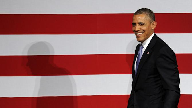 President Barack Obama smiles as he goes to walk off of the stage after speaking at a Democratic National Committee reception in San Jose, Calif., Thursday, May 8, 2014. Obama is spending three days in California raising money for the Democratic party. (AP Photo/Susan Walsh)