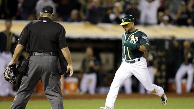 Crisp scores on wild pitch as A's beat Angels 2-1