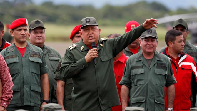 FILE - In this Oct. 20, 2011 file photo, Venezuela's President Hugo Chavez speaks to soldiers in La Fria, Venezuela. With Chavez now knocked low by a stubborn cancer and the future of his government in question, the armed forces may not be so prepared to hold the country together this time. A former military officer and several experts said the president's five-week absence has created a gaping hole at the top of the chain of command, one that the governing duo of Vice President Nicolas Maduro and National Assembly President Diosdado Cabello has proven incapable of filling. (AP Photo/Fernando Llano, File)