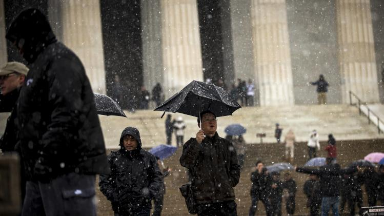 Crowds visit the Lincoln Memorial after the federal government closed for the day due to snow and ice in Washington
