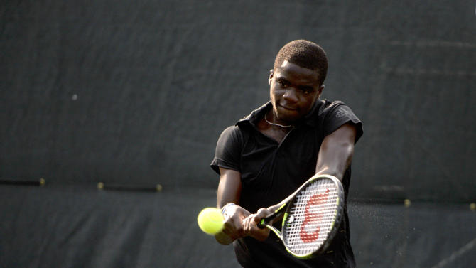 Frances Tiafoe, of the United States, returns a serve from James McGee, of Ireland, during the semifinals of the St. Joseph's/Candler Savannah Challenger tennis tournament in Savannah, Ga. on Saturday, April 25, 2015.  (IAN MAULE(/Savannah Morning News via AP) THE EXAMINER.COM OUT; SFEXAMINER.COM OUT; WASHINGTONEXAMINER.COM OUT