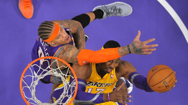 Los Angeles Lakers center Dwight Howard, right, puts up a shot as Phoenix Suns forward Michael Beasley defends during the first half of their NBA basketball game, Friday, Nov. 16, 2012, in Los Angeles. (AP Photo/Mark J. Terrill)