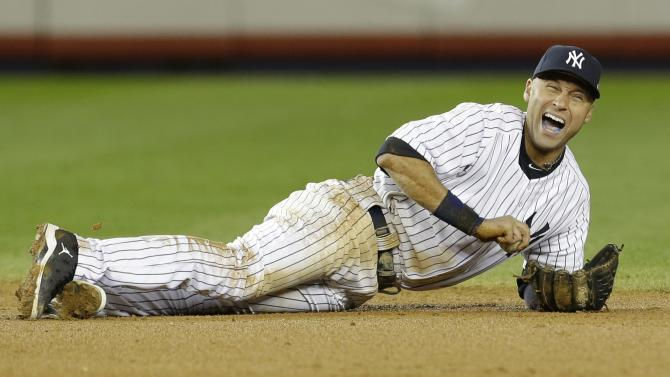 New York Yankees shortstop Derek Jeter reacts after injuring himself in the 12th inning of Game 1 of the American League championship series against the Detroit Tigers Sunday, Oct. 14, 2012, in New York. (AP Photo/Paul Sancya )
