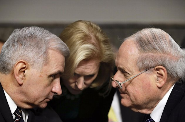 FILE – In this Jan. 31, 2013, file photo Democrat senators, from right, Carl Levin, D-Mich., Chairman of the Senate Armed Services Committee, Kirsten Gillibrand, D-N.Y., and Jack Reed, D-R.I., confer