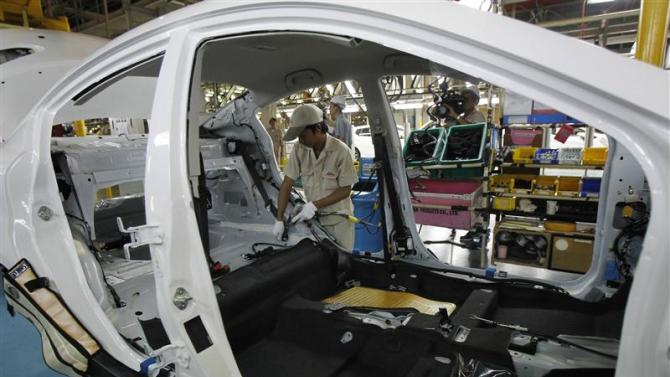 An employee works at an assembly line in AutoAlliance Thailand, a Ford and Mazda joint venture plant, located in Rayong province