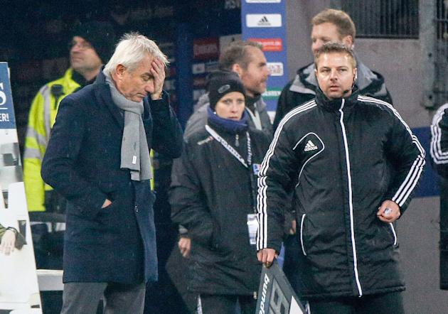 Hamburg's Dutch  head coach Bert van Marwijk , left,  leaves the stadium after the German Bundesliga match between Hamburger SV and FC Augsburg at Imtech Arena in Hamburg,Germany, Saturday Dec. 7,