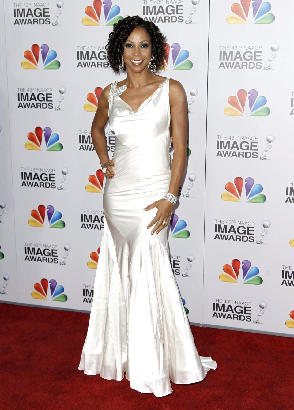 Holly Robinson Peete arrives at the 43rd NAACP Image Awards on Friday, Feb. 17, 2012, in Los Angeles. (AP Photo/Matt Sayles)