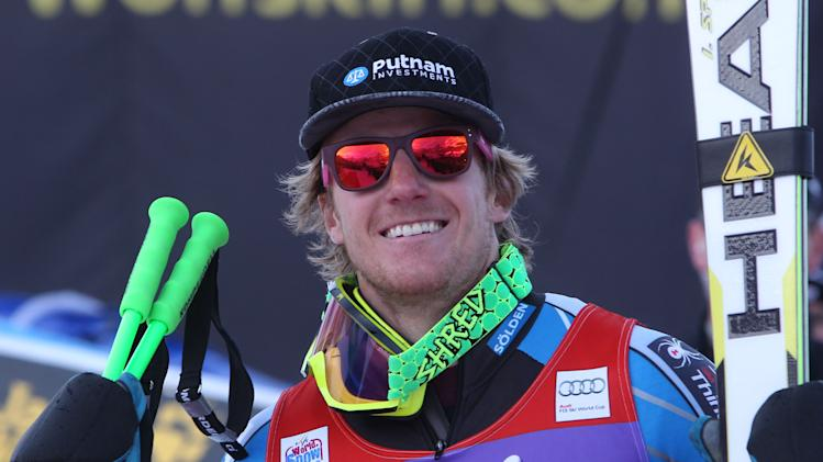 Ted Ligety from the United States celebrates after winning an alpine ski, men's World Cup giant slalom in Adelboden, Switzerland, Saturday, Jan.12, 2013. (AP Photo/Alessandro Trovati)