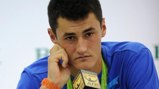 Bernard Tomic admitted to giving just &quot;85 per cent&quot; during his 6-4 6-0 defeat against Florian Mayer at the Shanghai Masters (AFP)