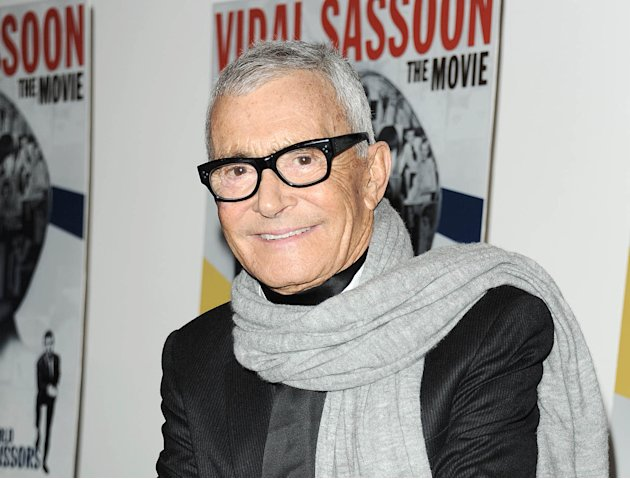 "In this  Feb. 9, 2011 file photo released by Starpix, hair designer and businessman, Vidal Sassoon, stops for a photo at a special screening of ""Vidal Sassoon: The Movie,"" in New York. Sassoon, whose"
