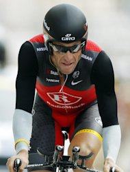 FILE - In this July 24, 2010, file photo, Lance Armstrong crosses the finish line during the 19th stage of the Tour de France cycling race, an individual time trial over 52 kilometers (32.3 miles), with a start in Bordeaux and finish in Pauillac, south western France. Armstrong said on Thursday, Aug. 23, 2012, that he is finished fighting charges from the United States Anti-Doping Agency that he used performance-enhancing drugs during his unprecedented cycling career, a decision that could put his string of seven Tour de France titles in jeopardy. (AP Photo/Laurent Rebours, File)
